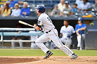 Asheville Tourists Grant Lavigne (34) swings at a pitch during a game against the Lakewood BlueClaws at McCormick Field on August 4, 2019 in Asheville, North Carolina. The Tourists defeated the BlueClaws 13-6. (Tony Farlow/Four Seam Images)