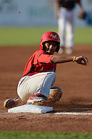Williamsport Crosscutters outfielder Gustavo Martinez (24) slides into third during a game against the Batavia Muckdogs on September 4, 2013 at Dwyer Stadium in Batavia, New York.  Williamsport defeated Batavia 6-3 in both teams season finale.  (Mike Janes/Four Seam Images)