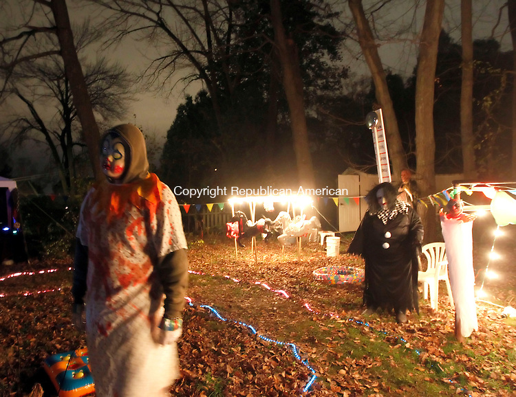 """Waterbury, CT-31 October 2012-103112CM08- Participants dressed in scary circus attire scare trick-or-treaters inside a """"haunted circus"""" at Sharon Giglio's residence on Alexander Ave Wednesday night in Waterbury. The event includes volunteers from the immediate and extended family, has been putting on various haunted themes for over ten years said Giglio.  Last night drew approximately 600 people.   Christopher Massa Republican-American"""