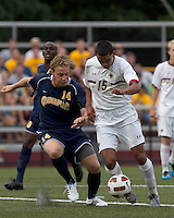 Boston College forward/midfielder Diego Medina-Mendez (15) drives for the net as Quinnipiac University defender Matthew Rothbart (14) defends. Boston College defeated Quinnipiac, 5-0, at Newton Soccer Field, September 1, 2011.