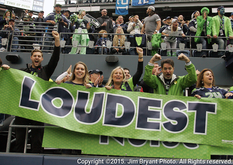 Seattle Seahawks  cheer against the Carolina Panthers  at CenturyLink Field in Seattle on October 18, 2015. The Panthers came from behind with 32 seconds remaining in the 4th Quarter to beat the Seahawks 27-23.  ©2015 Jim Bryant Photography. All Rights Reserved.
