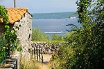 Garden door, Gartentor, old house, altes Haus, Porat, Krk Island, Dalmatia, Croatia. Insel Krk, Dalmatien, Kroatien. Krk is a Croatian island in the northern Adriatic Sea, located near Rijeka in the Bay of Kvarner and part of the Primorje-Gorski Kotar county. Krk ist mit 405,22 qkm nach Cres die zweitgroesste Insel in der Adria. Sie gehoert zu Kroatien und liegt in der Kvarner-Bucht suedoestlich von Rijeka.