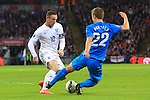 Ales Mertelj of Slovenia tackles Wayne Rooney of England - England vs. Slovenia - UEFA Euro 2016 Qualifying - Wembley Stadium - London - 15/11/2014 Pic Philip Oldham/Sportimage