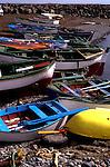 Fishing boats hauled on to stony beach Tenerife, Canary Islands, Spain