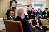 United States Secretary of Defense Ashton Carter, right, listens as U.S. President Barack Obama, left, speaks during a meeting with U.S. Vice President Joe Biden, center, in the Oval Office of the White House in Washington, D.C., U.S., on Tuesday, Feb. 17, 2015. Carter, sworn in as defense secretary today, inherits an array of defense and foreign policy challenges that are likely to help define the remaining two years of Obama's presidency. <br /> Credit: Andrew Harrer / Pool via CNP