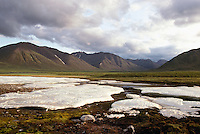 Snow Patches and Mountain Range along Dempster Highway (Hwy 5), Yukon Territory, Canada - Mid Summer