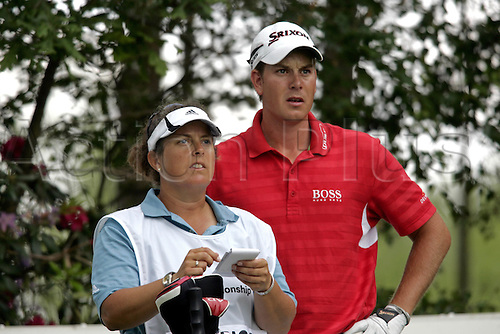 24 May 2007: Swedish golfer Henrik Stenson (SWE) and his caddy Fanny Sunesson during the first round of the BMW PGA Championship, West Course, Wentworth, England. Photo: Glyn Kirk/Actionplus....070524 golf