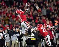 ATHENS, GA - NOVEMBER 09: Richard LeCounte #2 of the Georgia Bulldogs intercepts a pass by Kelly Bryant #7 of the Missouri Tigers during a game between Missouri Tigers and Georgia Bulldogs at Sanford Stadium on November 09, 2019 in Athens, Georgia.