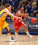 SIOUX FALLS, SD - MARCH 12:  Tempestt Wilson #3 from the University of South Dakota drives against Megan Waytashek #24 from South Dakota State University in the first half of the 2013 Women's Summit League Championship Game on Tuesday afternoon at the Sioux Falls Arena. (Photo by Dave Eggen/Inertia)