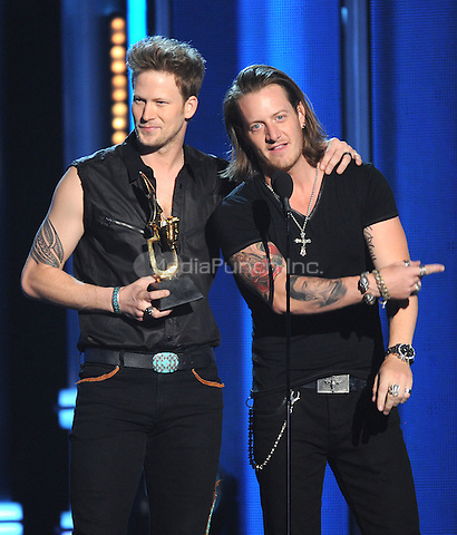 LAS VEGAS, NV - MAY 18: 5 Brian Kelly and Tyler Hubbard of Florida Georgia Line accept the Top Country Song award at the 2014 Billboard Music Awards at the MGM Grand Garden Arena on Sunday, May 18, 2014 in Las Vegas, Nevada. PgMicelotta/MediaPunch