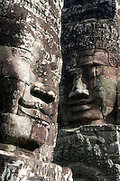 Giant faces smile in Bayon temple, in Angkor, Cambodia, on October 3, 2009. The Bayon temple was built in the late 12th century or early 13th century as the official state temple of the Mahayana Buddhist King Jayavarman VII. Angkor used to be the seat of the Khmer empire, which flourished from approximately the ninth century to the thirteenth century. The ruins of Angkor temples are a UNESCO World Heritage Site. Photo by Lucas Schifres/Pictobank.