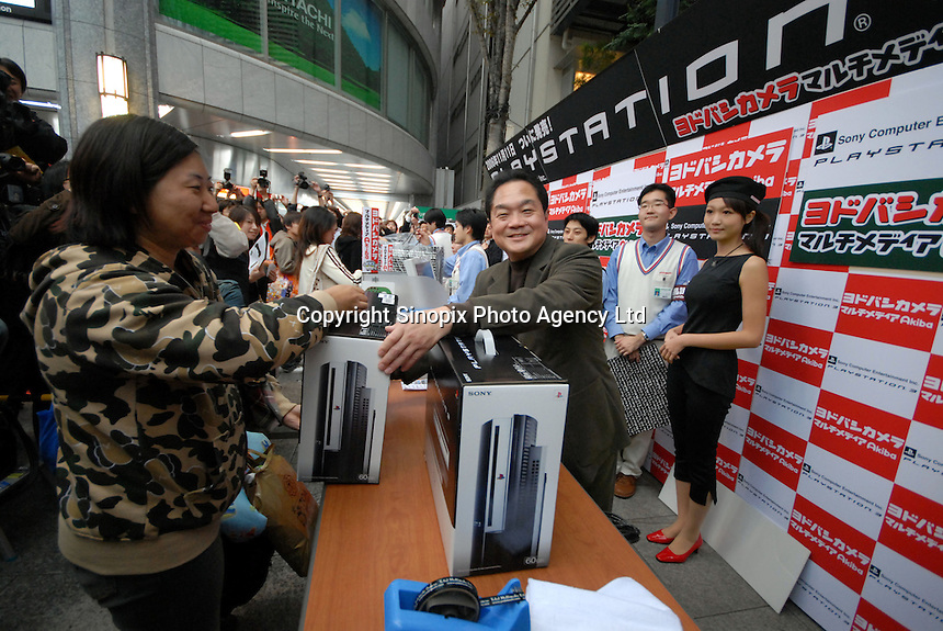 Sony Computer Entertainment CEO Kutaragi sells The Playstation 3 at Yodobashi Camera in Akihabara in Tokyo. The Playstation 3 goes on sale on Nov. 11 in Japan, a week later in the United States and next spring in Europe. But in cyberspace, it is all sold out which is good for Sony..