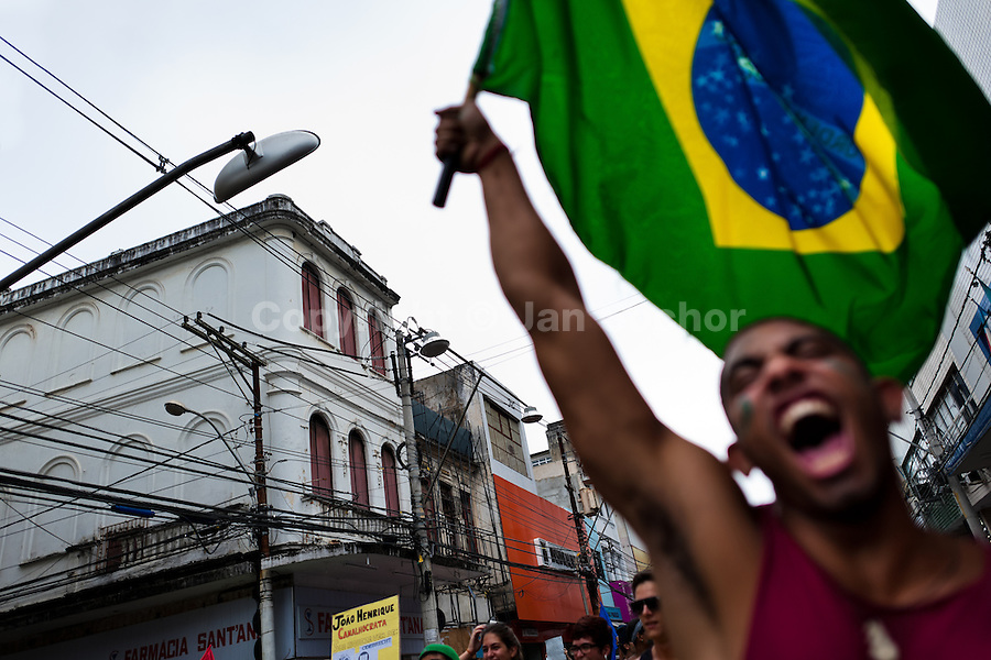 A radical protester, holding the Brazilian flag, screams during the protest march in Salvador, Bahia, Brazil, 1 February 2012.