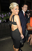 Billie Faiers & boyfriend Greg ?.attended the Kensington Club new boutique nightclub launch party, The Kensington Club, High Street Kensington, London, England,.20th July 2012..half length black dress straps back over shoulder rear behind .CAP/CAN.©Can Nguyen/Capital Pictures.