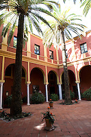 Graceful arches enclose the Palm Court courtyard in the Hacienda Benazuza providing a cool and shady area to sit, Sanlucar La Mayor, Spain