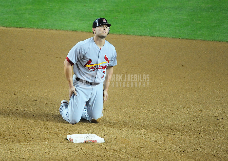 May 9, 2012; Phoenix, AZ, USA; St. Louis Cardinals base runner Matt Holliday reacts in the fifth inning after being forced out by the Arizona Diamondbacks at Chase Field. Mandatory Credit: Mark J. Rebilas-