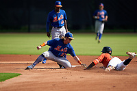 GCL Mets second baseman Nick Conti (27) tags Yefri Carrillo (23) sliding in as shortstop Federico Polanco (44) looks on during a Gulf Coast League game against the GCL Astros on August 10, 2019 at FITTEAM Ballpark of the Palm Beaches Training Complex in Palm Beach, Florida.  GCL Astros defeated the GCL Mets 8-6.  (Mike Janes/Four Seam Images)