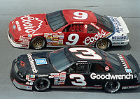 Dale Earnhardt (#3) and Bill Elliott side-by-side at Daytona during a qualifying race for the 1990 Daytona 500.(Photo by Brian Cleary)