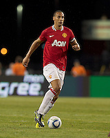 Manchester United FC defender Rio Ferdinand (5) at midfield. In a Herbalife World Football Challenge 2011 friendly match, Manchester United FC defeated the New England Revolution, 4-1, at Gillette Stadium on July 13, 2011.