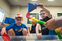 NWA Democrat-Gazette/BEN GOFF @NWABENGOFF<br /> Mason Virden (left), 3, of Lowell and Braxton Strode, 4, of Rogers play in the sand Wednesday, Feb. 7, 2018, during a 'Hands On!' sensory program for ages 0-12 at the Rogers Public Library. The program offered a variety of toys and materials for children to explore and make crafts.