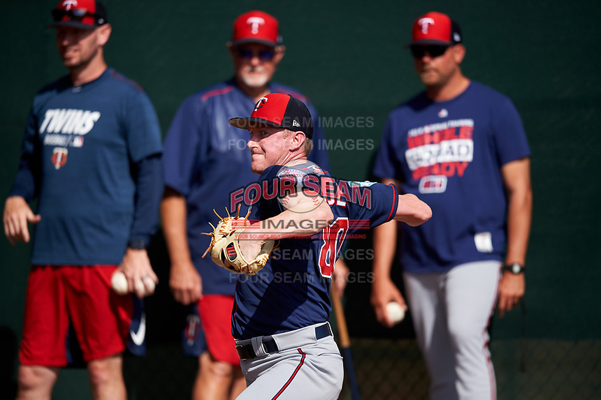 Minnesota Twins pitcher Ryan Eades (80) throws in the bullpen as (L-R) Jeremy Hefner, Bert Blyleven, and J.P. Martinez look on during a Spring Training practice on February 22, 2019 at Hammond Stadium in Fort Myers, Florida.  (Mike Janes/Four Seam Images)
