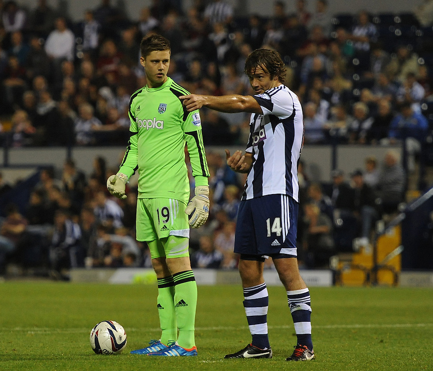West Bromwich Albion's Luke Daniels and Diego Lugano in discussion during todays game<br /> <br /> Photo by Ashley Crowden/CameraSport<br /> <br /> Football - Capital One Cup Second Round - West Bromwich Albion v Newport County - Tuesday 27th August 2013 - The Hawthorns - West Bromwich<br />  <br /> &copy; CameraSport - 43 Linden Ave. Countesthorpe. Leicester. England. LE8 5PG - Tel: +44 (0) 116 277 4147 - admin@camerasport.com - www.camerasport.com