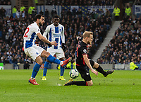 Brighton & Hove Albion's Martin Montoya (left) crosses the ball despite the attentions of Huddersfield Town's Alex Pritchard (right) <br /> <br /> Photographer David Horton/CameraSport<br /> <br /> The Premier League - Brighton and Hove Albion v Huddersfield Town - Saturday 2nd March 2019 - The Amex Stadium - Brighton<br /> <br /> World Copyright © 2019 CameraSport. All rights reserved. 43 Linden Ave. Countesthorpe. Leicester. England. LE8 5PG - Tel: +44 (0) 116 277 4147 - admin@camerasport.com - www.camerasport.com