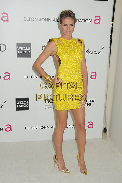 Heidi Klum.20th Annual Elton John Academy Awards Viewing Party held at West Hollywood Park, West Hollywood, California, USA..February 26th, 2012.full length yellow gold embroidered sleeveless dress hand on hip shoes .CAP/ADM/BP.©Byron Purvis/AdMedia/Capital Pictures.
