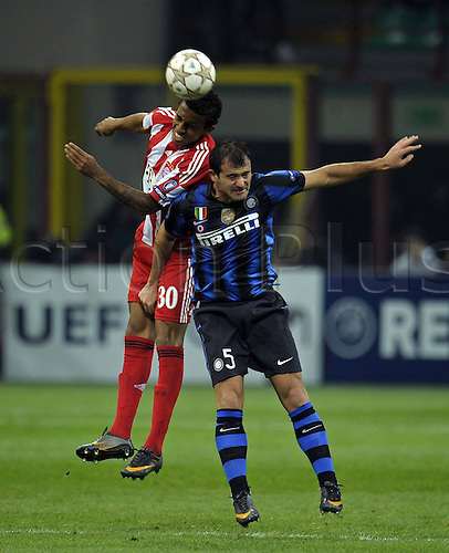 23 02 2011  ootball Champions League Inter Milan versus FC Bayern  Munich in Stadium Giuseppe Meazza Luiz Gustavo Munich against Dejan Stankovic Milan