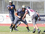 Palos Verdes, CA 09-07-18 - Ethan Gretzinger (Peninsula #5), Carlos Ocegueda (Peninsula #75) and Skyler York (Torrance #60) in action during the Torrance - Palos Verdes Peninsula Varsity football game.