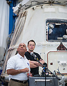 NASA Administrator Charles Bolden, left, and SpaceX CEO and Chief Designer Elon Musk, view the historic Dragon capsule that returned to Earth on May 31 following the first successful mission by a private company to carry supplies to the International Space Station on Wednesday, June 13, 2012 at the SpaceX facility in McGregor, Texas.  Bolden and Musk also thanked the more than 150 SpaceX employees working at the McGregor facility for their role in the historic mission. Photo Credit: (NASA/Bill Ingalls).Mandatory Credit: Bill Ingalls / NASA via CNP
