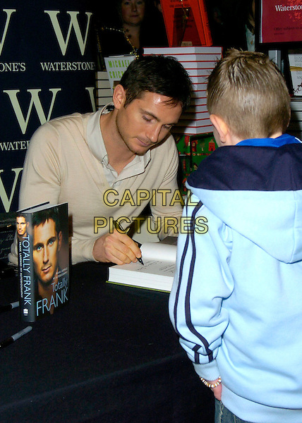 FRANK LAMPARD.Booksigning at Waterstone's bookshop, Leadenhall Market,  London, UK..November 30th, 2006.half length beige jumper signing autograph.CAP/CAN.©Can Nguyen/Capital Pictures