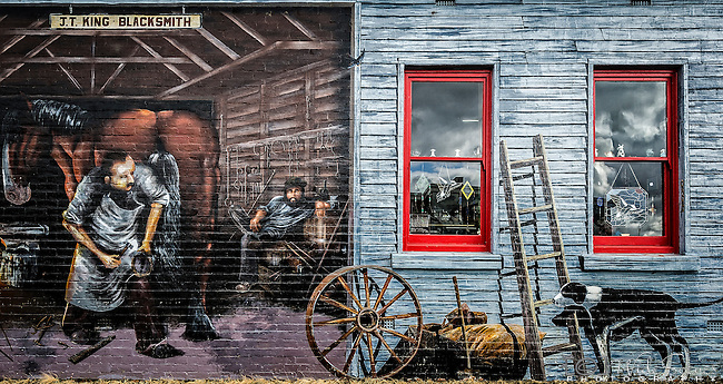 An intricate mural on the side of a building in Sheffield in Tasmania depicts the Australian colonial era.