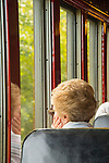 Essex, CT Steam Train excursion. Woman looking out window.
