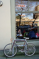 Bicycle parked outside a coffee shop in downtown Bellingham, Washington State, USA              .