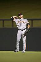 Scottsdale Scorpions right fielder Heath Quinn (45), of the San Francisco Giants organization, throws in the outfield during an Arizona Fall League game against the Salt River Rafters at Salt River Fields at Talking Stick on October 11, 2018 in Scottsdale, Arizona. Salt River defeated Scottsdale 7-6. (Zachary Lucy/Four Seam Images)