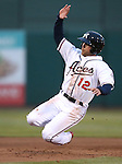 Reno Aces' Ender Inciarte steals third against the El Paso Chihuahuas on opening day in Reno, Nev., on Thursday, April 3, 2014. <br /> Photo by Cathleen Allison