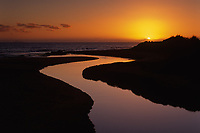 Stream Flowing into Ocean at Sunset, Barking Sands, Kauai, Hawaii, USA.