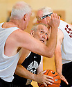 Jim Poteet, 68, middle, of Oklahoma West's men's 65+ Basketball team, moves to take a shot as Bill Carrigg, 68, left and Gerald Taylor, 71, far right, of Taylor Law try to stop him. During the Senior Games 2009, at Stanford University's Arillage Recreation Center, in Palo Alto, Calif., on Thursday, August 06, 2009.
