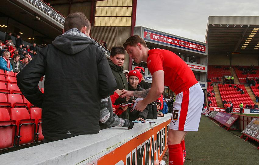 Barnsley's Alfie Mawson signs autographs for fans.<br /> <br /> Photographer Alex Dodd/CameraSport<br /> <br /> Football - The Football League Sky Bet League One - Barnsley v Rochdale - Saturday 23rd January 2016 - Oakwell Stadium - Barnsley    <br /> <br /> &copy; CameraSport - 43 Linden Ave. Countesthorpe. Leicester. England. LE8 5PG - Tel: +44 (0) 116 277 4147 - admin@camerasport.com - www.camerasport.com