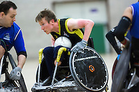 27 MAY 2013 - DONCASTER, GBR - Luke White (centre) of Stoke Mandeville Storm looks for a way through the Kent Crusaders defence during the 2013 Great Britain Wheelchair Rugby Nationals final at The Dome in Doncaster, South Yorkshire .(PHOTO (C) 2013 NIGEL FARROW)