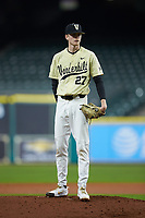 Vanderbilt Commodores starting pitcher Chandler Day (27) looks to his catcher for the sign against the Houston Cougars during game nine of the 2018 Shriners Hospitals for Children College Classic at Minute Maid Park on March 3, 2018 in Houston, Texas. The Commodores defeated the Cougars 9-4. (Brian Westerholt/Four Seam Images)