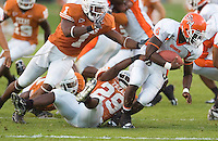 30 September 2006: Sam Houston State player Derrick Harris (#6) is tackled by Longhorn defenders Tyrell Gatewood (#1) and Ryan Palmer (#29) on a kick off return during the Bearkats 56-3 loss to the University of Texas Longhorns at Darrell K Royal Memorial Stadium in Austin, TX.