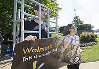 NWA Democrat-Gazette/BEN GOFF @NWABENGOFF<br /> Ben Williamson, campaign director for World Animal Protection based in New York, and Joanna Gonzalez, a volunteer from Siloam Springs, demonstrate Wednesday, June 5, 2019, outside the Walmart shareholders formal business meeting at the John Q. Hammons Center in Rogers. The organization was lobbying for Walmart to source pork from suppliers that do not keep mother pigs in gestation crates.