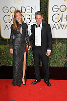 Hugh Grant &amp; Anna Eberstein at the 74th Golden Globe Awards  at The Beverly Hilton Hotel, Los Angeles USA 8th January  2017<br /> Picture: Paul Smith/Featureflash/SilverHub 0208 004 5359 sales@silverhubmedia.com