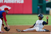 Jose Thompson (43) of the Corpus Christi Hooks slides into third base during a game against the Springfield Cardinals at Hammons Field on August 13, 2011 in Springfield, Missouri. Springfield defeated Corpus Christi 8-7. (David Welker / Four Seam Images)