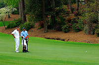 Masters Golf Tournament 2005, Augusta National Georgia, USA. Tiger Woods and his caddy Steve Williams on the 13th hole, Azalea.<br /> <br /> Champion 2005 - Tiger Woods <br /> <br /> Note: There is no property release or model release available for this image.