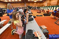 NWA Democrat-Gazette/FLIP PUTTHOFF <br /> AIR GUN CHAMPOINSHIP<br /> Jill Crumley (from left), her daughter Marcie, 6, and father-in-law Dwayne Crumley, all from Georgia, watch shooting matches on Saturday July 6 2019 at the annual Daisy National BB Gun Championships in Rogers. Some 450  youths age 8 to 15 from around the United States qualified for the championship held at the John Q. Hammons Center.