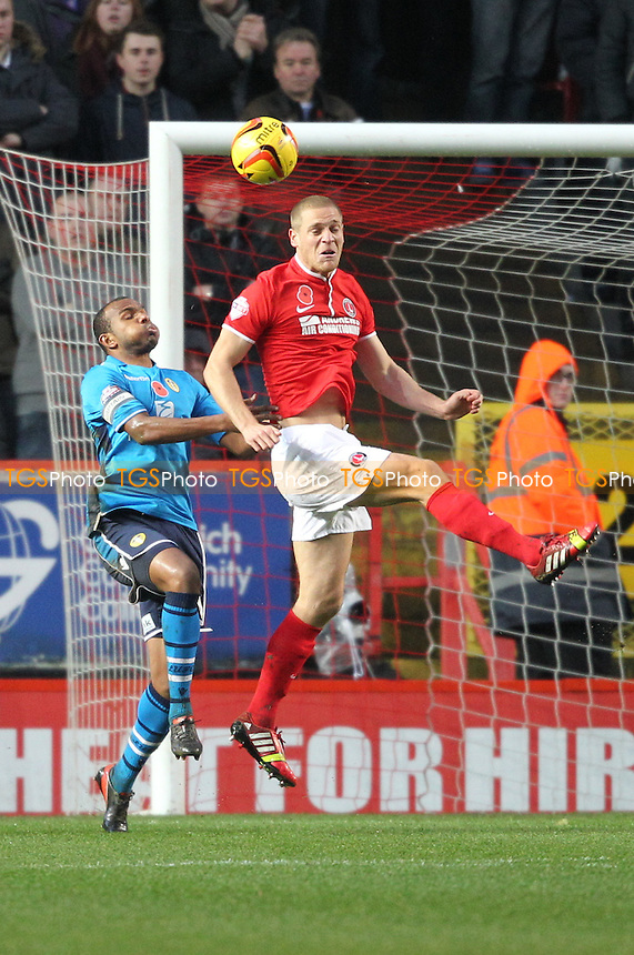 Michael Morrison of Charlton Athletic rises for a header - Charlton Athletic vs Leeds United - Sky Bet Championship Football at The Valley, London - 09/11/13 - MANDATORY CREDIT: Simon Roe/TGSPHOTO - Self billing applies where appropriate - 0845 094 6026 - contact@tgsphoto.co.uk - NO UNPAID USE