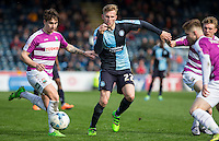 Jason McCarthy of Wycombe Wanderers goes past Sam Muggleton (left) of Barnet during the Sky Bet League 2 match between Wycombe Wanderers and Barnet at Adams Park, High Wycombe, England on 16 April 2016. Photo by Andy Rowland.
